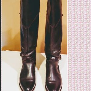 Knee  high Frye riding boots.
